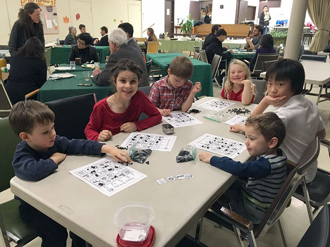 Children at table playing a christmas game